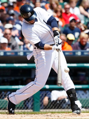 Detroit Tigers designated hitter  J.D. Martinez hits a single in the second inning against the Minnesota Twins at Comerica Park.