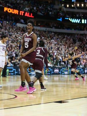 Mississippi State's Teaira McCowan (15) reacts as MSU sinks a shot against UConn.