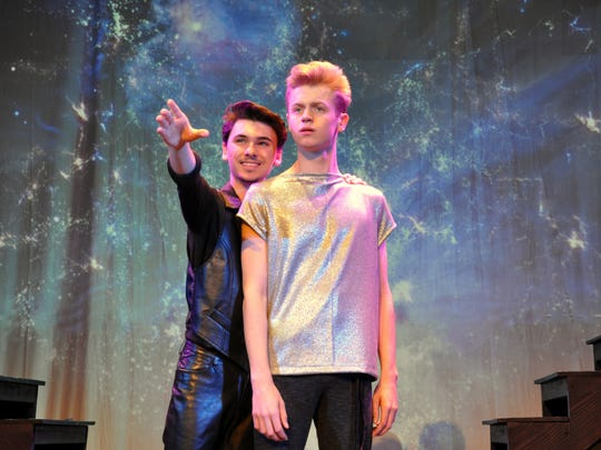 "Pippin (Nate Jones) is encouraged by the Leading Player (Jacob Higdon) to search for his corner of the sky in the Young Actors Theatre production of ""Pippin."""