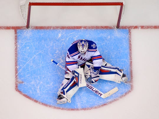 New York Rangers goalie Henrik Lundqvist, of Sweden, sits on the ice after being scored on by Los Angeles Kings right wing Dustin Brown to win the game during the second overtime period in Game 2 of the NHL hockey Stanley Cup Finals, Saturday, June 7, 2014, in Los Angeles. The Kings won 5-4.  (AP Photo/Mark J. Terrill)