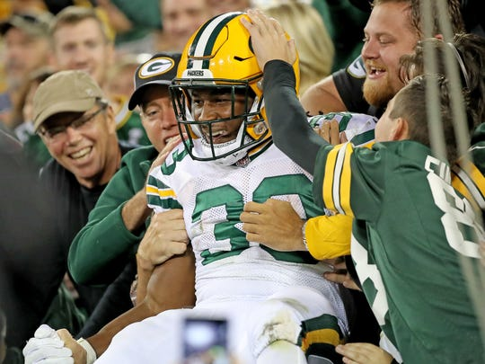 Green Bay Packers running back Aaron Jones (33) celebrates his touchdown with a Lambeau Leap Thursday, September 28, 2017 against the Chicago Bears at Lambeau Field in Green Bay, Wis.