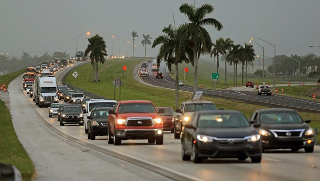 Traffic is seen heading North along the Florida Turnpike near Homestead, Fla., as tourists in the Florida Keys leave town on Sept. 6, 2017.