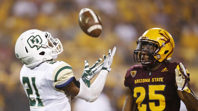 ASU's Kareem Orr (25) closes-in on Cal Poly's Chris Fletcher at Sun Devil Stadium on Sep. 12, 2015 in Tempe, AZ.