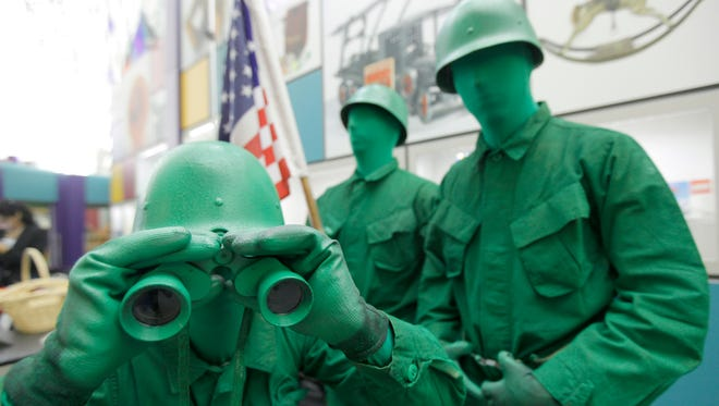 Little green army men (actors impersonating them here), Rubik's Cube, and bubbles make the National Toy Hall of Fame at the National Museum of Play at The Strong in Rochester.