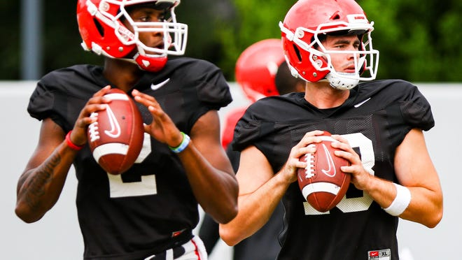 Georgia quarterbacks D'Wan Mathis (2) and Georgia JT Daniels (18), during the Bulldogs' practice session in Athens on Sept. 9.