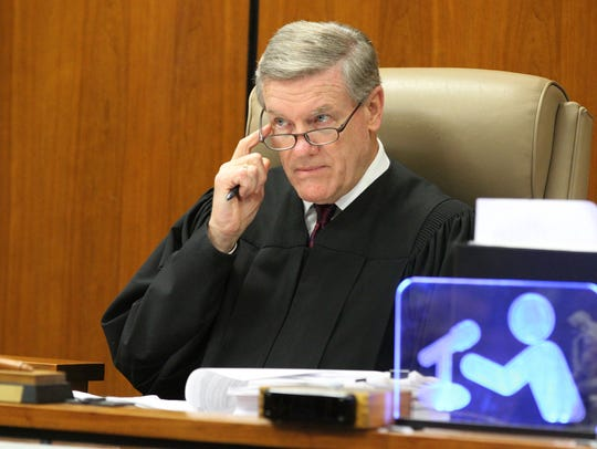 Judge James M. Blaney presides over the sentencing