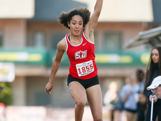 Santiam Christian's Rebeka Preston competes in the 3A girls triple jump at the OSAA Track and Field Championships on Friday, May 18, 2018, at Hayward Field in Eugene.