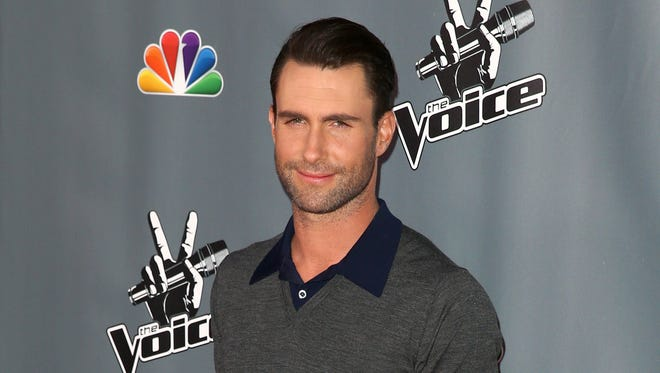 Adam Levine is officially the sexiest man alive, according to People mag! (Sorry ladies, he's engaged.)