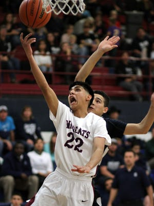 Senior Deming Wildcat Elias Vigil (22) found an open lane to the basket during the first half ot Tuesday's 55-53 Wildcat loss to the visiting Silver High Fighting Colts.