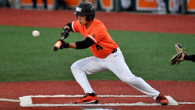 OSU outfielder Steven Kwan bunts for a base hit in the Beavers' 8-1 victory over Yale in the Corvallis Regional on June 4, 2017.