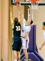 Hardin-Simmons' Justin Jones (40) blocks the shot of Emory's Austin DaGue (32) during the first half the Cowboys' 95-85 win in the second round of the NCAA men's basketball tournament last week.