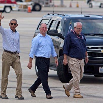 President Barack Obama, accompanied by Louisiana Gov.