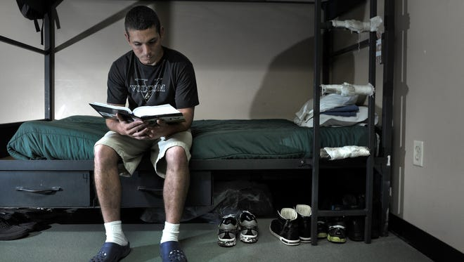 Studying the Bible in his room on May 13, Levi Drouillard, 24, was homeless in Florida and came to Nashville to get into the program at the Nashville Rescue Mission. Drouillard has been in the program for about 2 months.
