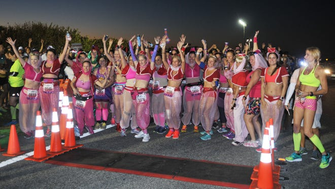 """The Ron Jon Cocoa Beach Half Marathon is known for its """"I Dream of Genie"""" theme with runners dressing like the character made famous by Barbara Eden, as well as Genie bottle medals."""