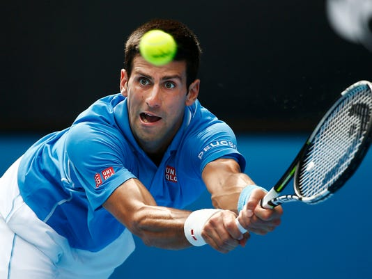 Djokovic of Serbia hits a return to Bedene of Slovenia during their men's singles match at the Australian Open 2015 tennis tournament in Melbourne