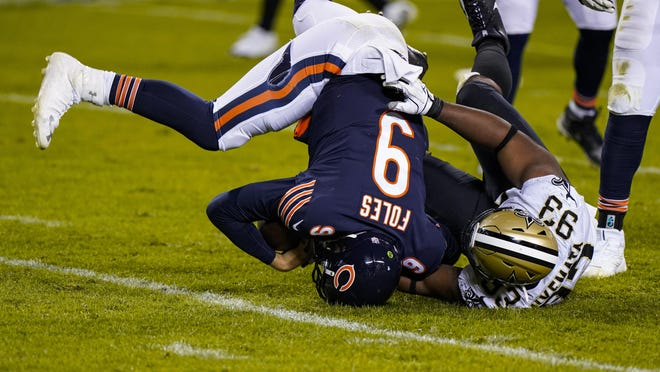 New Orleans Saints defensive tackle David Onyemata (93) sacks Chicago Bears quarterback Nick Foles (9) in overtime of an NFL football game in Chicago, Sunday, Nov. 1, 2020.
