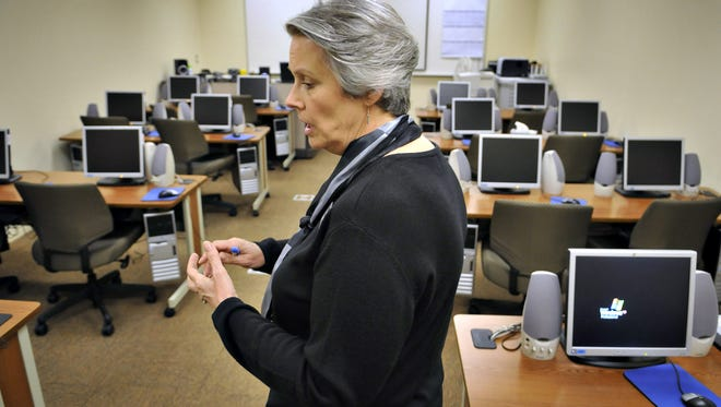 Kathy Zavala, executive director of the Stearns-Benton Employment Training Council, talks in 2011 between classes in a computer lab used to teach computer and employment skills.