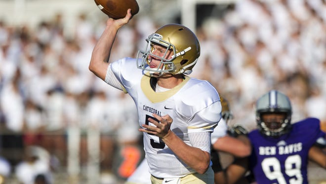 Cathedral High School junior Max Bortenschlager (5)  fires a pass off to a receiver during the first half of action at Ben Davis High School, Friday, August 22, 2014. Ben Davis High School hosted Cathedral High School in varsity football action.
