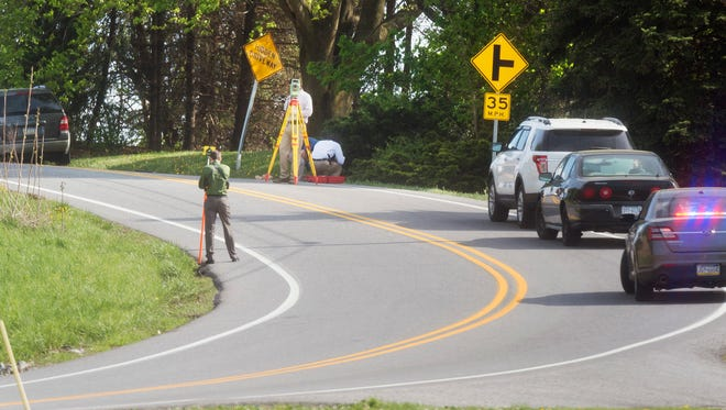 Police investigate where a person was struck on Windsor Road near John Norris Boulevard on Tuesday in Windsor Township.