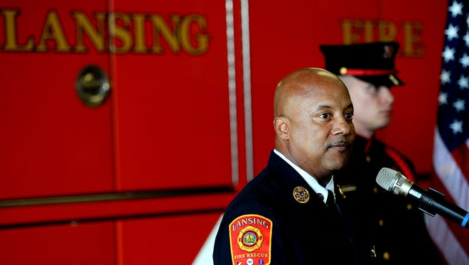 """Lansing Fire Chief Randy Talifarro speaks during the memorial service for Dennis Rodeman marking the one-year anniversary of his death at Fire Station #1 in downtown Lansing. Rodeman died after being hit by a vehicle while collecting donations for the """"Fill the Boot"""" campaign."""