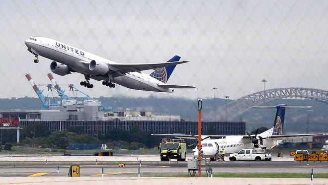 FILE - In this July 25, 2013, file photo, a United Airlines plane takes off from Newark Liberty International Airport, in Newark, N.J. (AP Photo/Julio Cortez, File)