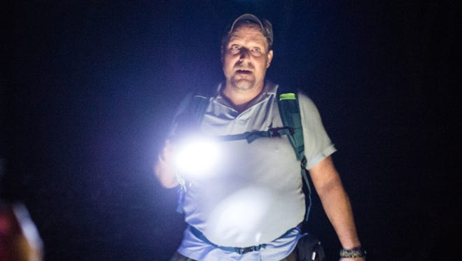 Dave Levack uses a flashlight as they search for a Sasquatch a forest located in Schyulkill County on Saturday, May 27, 2017