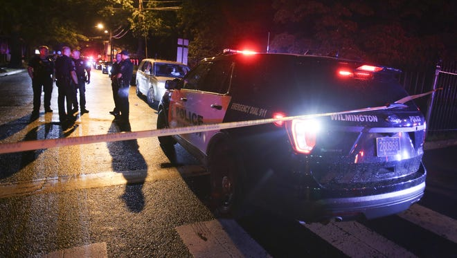 Wilmington police investigate a shooting on the 400 block of Washington Street earlier this month. A new survey asks the public to give their thoughts on the relationship between the community and law enforcement.
