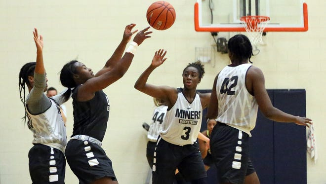 UTEP guard Roeshonda Patterson, center, passes the ball to a teammate during Wednesday's practice at the Foster-Stevens basketball complex on the UTEP campus.