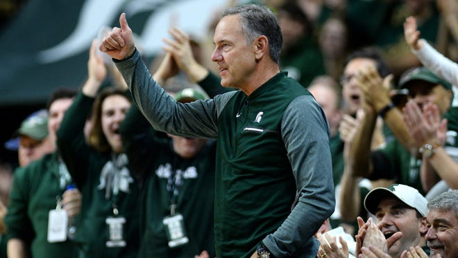 Michigan State head football coach Mark Dantonio is recognized by the crowd during the second half on Thursday, Jan. 4, 2018, at the Breslin Center in East Lansing. The Spartans won 91-61.