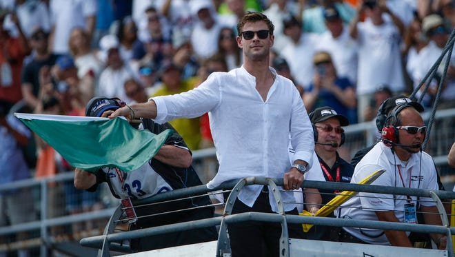 Actor Chris Hemsworth waves the green flag to start the 102nd running of the Indianapolis 500 at Indianapolis Motor Speedway on Sunday, May 27, 2018.