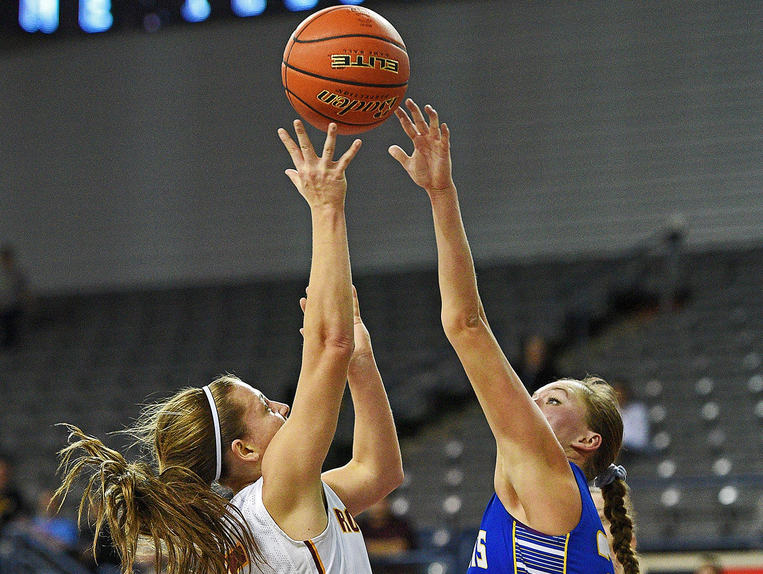 Roosevelt's Taylor Bonestroo (5) goes up for a shot as O'Gorman's Kendyl Kreber (24) defends during a 2017 SDHSAA Class AA State Girls Basketball quarterfinal game Thursday, March 16, 2017, at Rushmore Plaza Civic Center in Rapid City. O'Gorman beat Roosevelt 37-33.