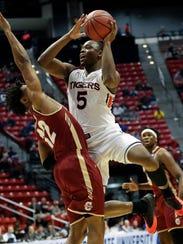 Auburn guard Mustapha Heron (5) shoots as Charleston