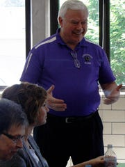 Tom Otten, who served 19 years as principal at Elder High School, chats with staff members during lunch on his last day working at the school. Otten retired June 30, after a 55-year career at the West Side school.