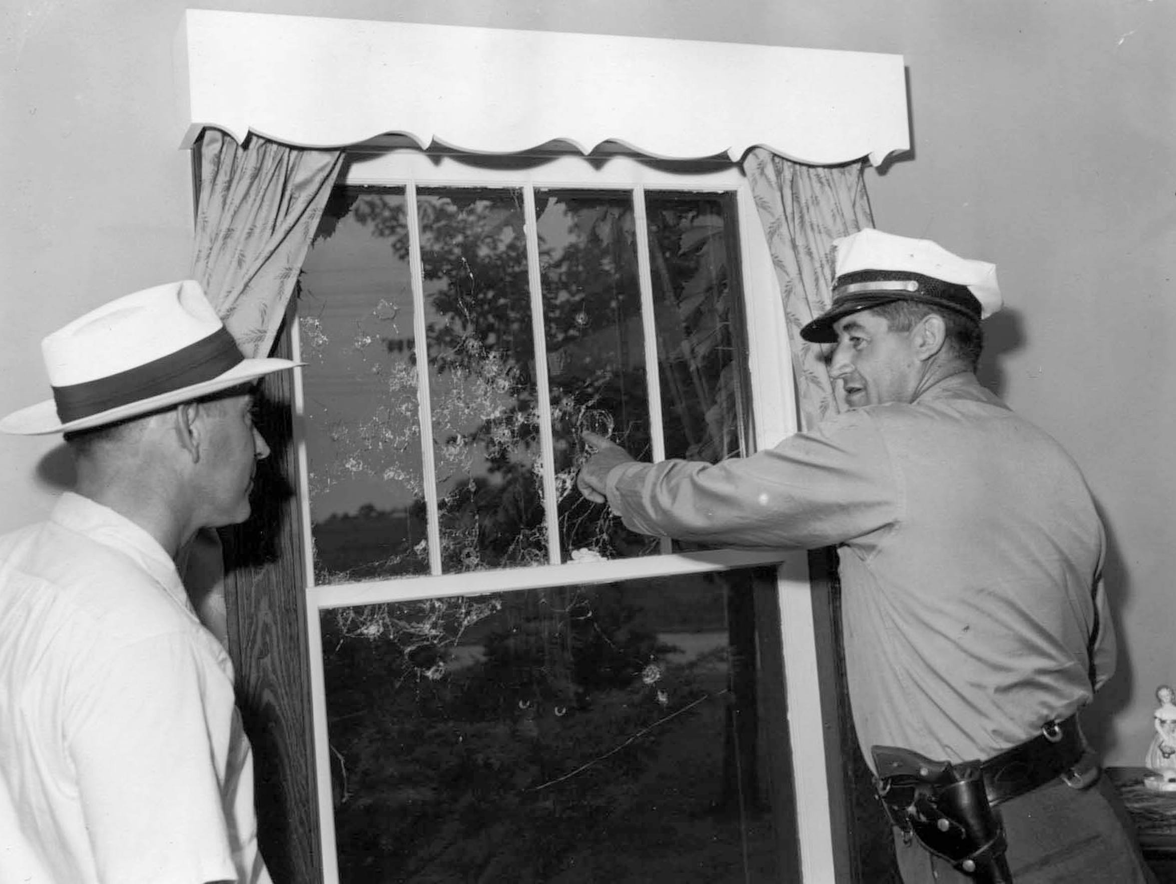 6-29-1954 Shotgun blast window at Harold J. curtis,