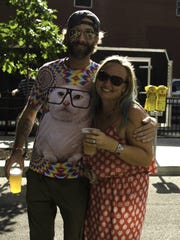 Jordan Cloe, 37, of Costa Rica, and Steph Barnes, 32, of Bondurant  at the 80/35 Music Festival.