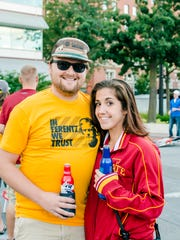 Justin Campbell, 28, of Ankeny, and Natasha Ellis, 25, of Des Moines, having a great time at the Touchdown Tailgate hosted by Cowles Commons.