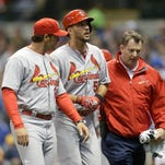 MILWAUKEE, WI - APRIL 25: Adam Wainwright #50 of the St. Louis Cardinals is helped off the field after his at bat in the fifth inning during the game against the Milwaukee Brewers at Miller Park on April 25, 2015 in Milwaukee, Wisconsin. (Photo by Mike McGinnis/Getty Images)  *** Local Caption *** Adam Wainwright