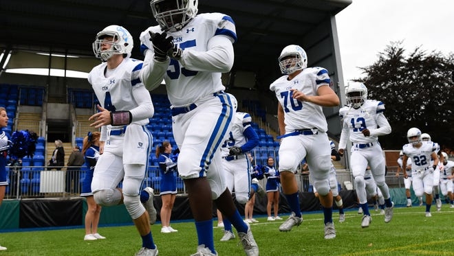 Community School Naples football team takes the field for the American Football Showcase at Donnybrook Stadium in Dublin, Ireland, on Friday, ,Sept. 2, 2016.