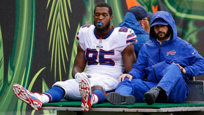 Buffalo Bills tight end Charles Clay (85) is carted off the field in the first half of an NFL football game against the Cincinnati Bengals, Sunday, Oct. 8, 2017, in Cincinnati.