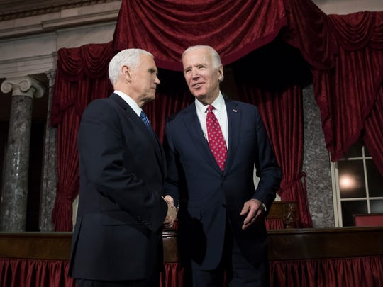 Vice President Mike Pence, left, shakes hands with former Vice President Joe Biden, after a ceremonial swearing-in for Sen. Doug Jones, D-Ala., at the Capitol in Washington, Wednesday, Jan. 3, 2018.  (AP Photo/J. Scott Applewhite) ORG XMIT: DCSA114