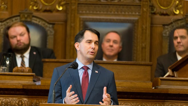 Gov. Scott Walker is shown during his budget address Wednesday at the Capitol in Madison. Walker's proposed two-year budget increases funds for local schools, the University of Wisconsin System and $592 million in cuts to taxes, fees and tuition over the next two years.
