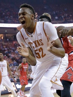 Texas' Myles Turner reacts as he loses control of the ball against Texas Tech on Feb. 14, 2015, in Austin, Texas.
