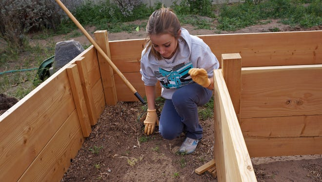 Jessica Llewellyn, a student at Santa Teresa High School and the TRiO and Upward Bound programs at NMSU, helped clean up the community garden at University United Methodist Church.