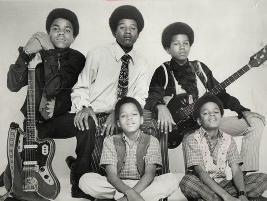 The Jackson 5 early in their Motown career: (rear,