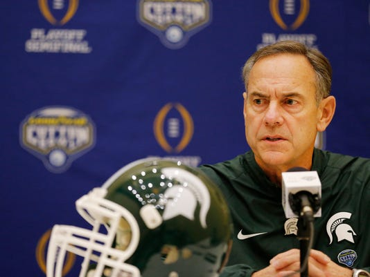 CORRECTS TO MARK DANTONIO NOT MIKE DANTONIO - Michigan State head coach Mark Dantonio speaks during a media availability with the football team in Grapevine, Texas, ahead of their NCAA College Football Playoff's Cotton Bowl semifinal against Alabama, Saturday, Dec. 26, 2015. (Andy Jacobsohn/The Dallas Morning News via AP)  MANDATORY CREDIT; MAGAZINES OUT; TV OUT; INTERNET USE BY AP MEMBERS ONLY; NO SALES