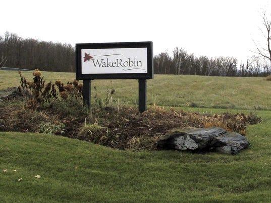 636477406840530064-Wake-Robin-Sign.jpg