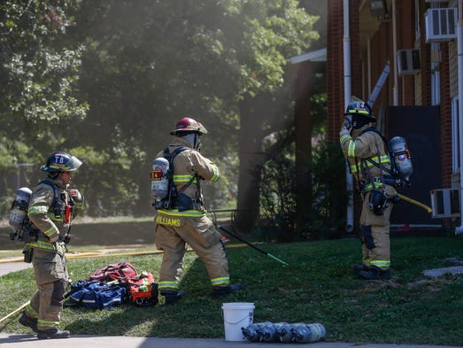 Fire crews work the scene of a fire at the John B.