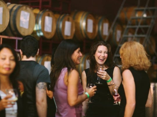 Attendees at a previous CUT artisan. hair. design. Trend Event enjoying wine from Grape Finale. Wine from