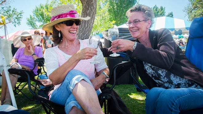 Sylvia Sweat and Lyntha Masterson toast after finishing glasses of wine at  a previous La Viña Winery annual Spring Wine Festival.