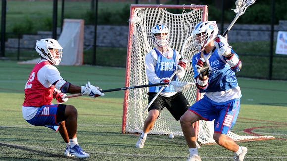 JT Giles-Harris of Nyack, left, defends against Kevin Lewis of Morris Plains, N.J. while practicing with the Puerto Rican national lacrosse team at Nyack High School June 29, 2018. In goal is Will Ramos of Nyack. The team will be traveling to Israel next month to play in the FIL World Championships. Several player on the team are from Westchester and Rockland counties.
